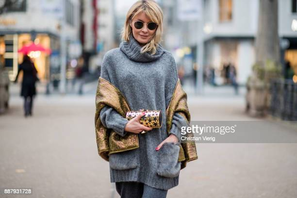 Gitta Banko wearing a grey oversize knit turtleneck sweater with fake fur pockets by Zara grey cottonwoolmix flared trousers with button details on...