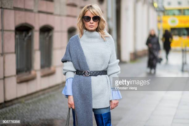 Gitta Banko wearing a lightblue blouse with trompe sleeves by Smith Soul grey oversize turtleneck knit sweater by Smith Soul jeans by Current Elliott...