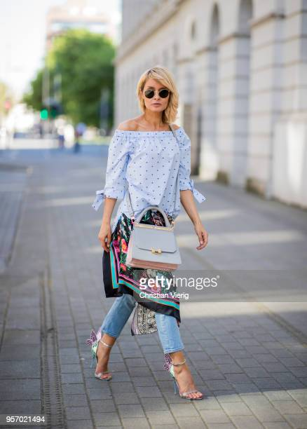 Gitta Banko wearing a lightblue dotted offshoulder blouse by GR8FUL light cropped jeans by Closed patterned silk scarfs by Black Coral and Jadicted...