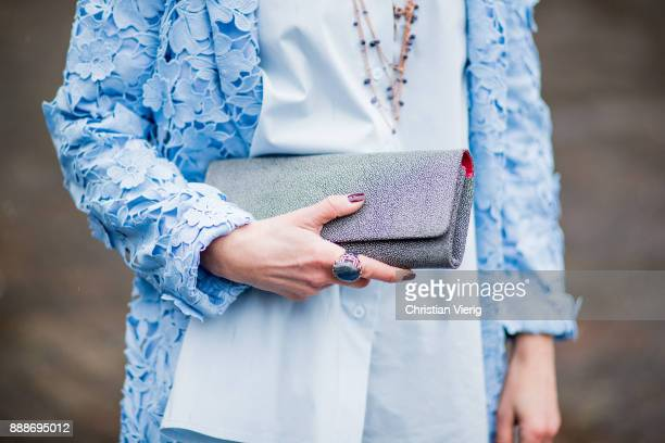 Gitta Banko wearing a lightblue trench coat with floral pattern and lace and lightblue flared blouse with V neck by Steffen Schraut grey turtelneck...