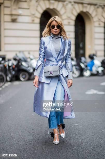 Gitta Banko wearing a lightgrey cashmere turtleneck sweater by Bruno Manetti long shiny lightblue taffeta vest and blazer by Dawid Tomaszewski for...