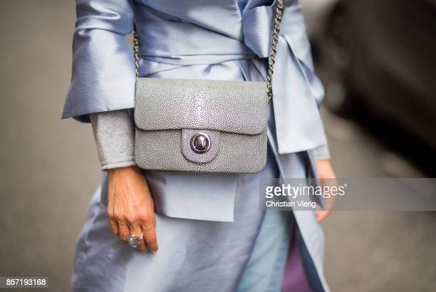 Gitta Banko wearing a lightgrey cashmere turtleneck sweater by Bruno Manetti long shiny lightblue taffeta vest and blazer by Dawid Tomaszewski for...