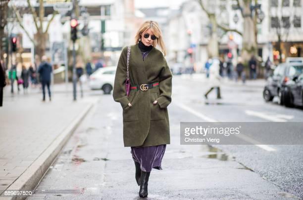 Gitta Banko wearing a lilac velvet dress and an green oversized knitted cardigan by Dawid Tomaszewski logo belt from Gucci black tubular nappa...