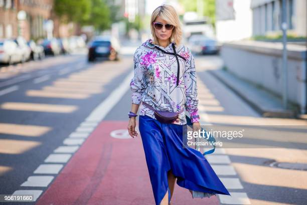 Gitta Banko wearing a midnight blue asymmetrical leather skirt from Topshop hoody with printed floral and Bauhaus pattern by Dawid Tomaszewski purple...