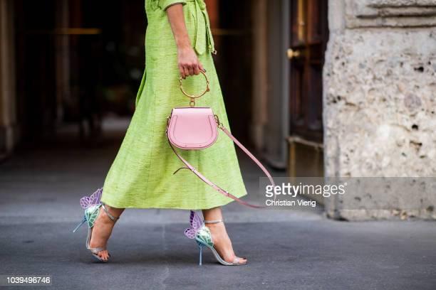 Gitta Banko wearing a neon green coat by Danny Reinke white tshirt with saddle bag print by Wodka Ogurez shiny green pleated skirt by Dawid...