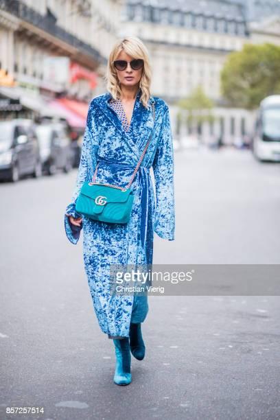 Gitta Banko wearing a patterned silk blouse in pajama style by Steffen Schraut blue shiny velvet kimono coat by Dawid Tomaszewski Cora jeans in used...