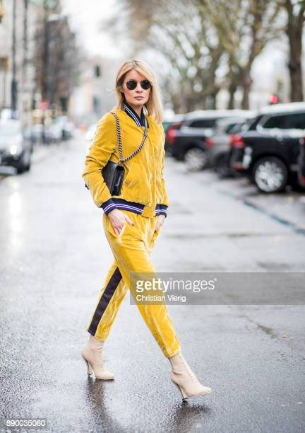 Gitta Banko wearing a saffron yellow colored bomber jacket made of velvet with saffron yellow colored velvet pants by Dawid Tomaszewski nudecolored...