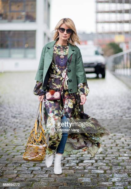 Gitta Banko wearing a silk tiered maxi dress with bell sleeves by Uli Herzner palmgreen jeans by Citizen of Humanity short leather jacket by Steffen...
