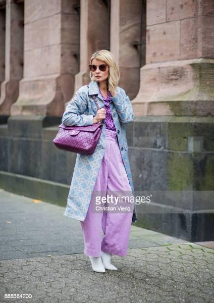 Gitta Banko wearing a silvergrey coat with lightblue pattern by Dawid Tomaszewski purple blouse with bird print by HUGO lavender colored high waist...