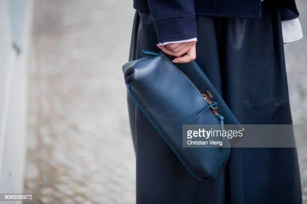 Gitta Banko wearing a total Agnona look containing a lightblue silk top darkblue cabanstyle cashmere jacket darkblue leather skirt black tubular...