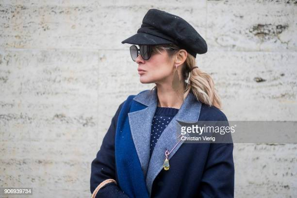 Gitta Banko wearing a total Agnona look containing a navy blue white dotted knit sweater with green sleeves navy blue cashemere scarf dark blue...