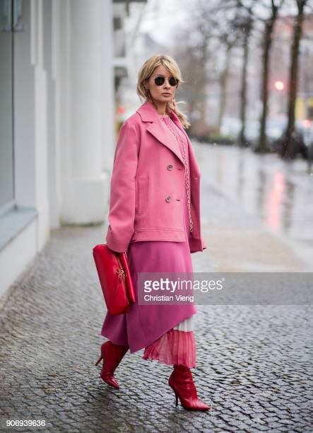 Gitta Banko wearing a total Agnona look containing a pinkcolored cabanstyle cashmere jacket pink caftan lightpink cashmere sweater ivory and pink...
