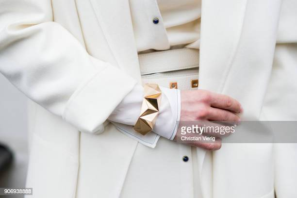 Gitta Banko wearing a total Agnona look containing a white silk longsleeve shirt, white silk-cotton-mix trousers, ivory colored long vest with tiny...