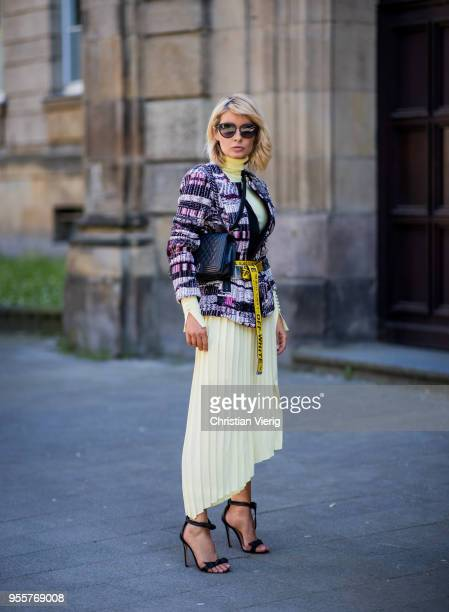 Gitta Banko wearing a tweed jacket by AirField lightyellow turtleneck sweater from Zara yellow pleated skirt from Mango yellow belt by OffWhite black...