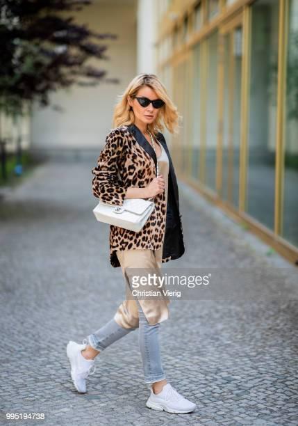 Gitta Banko wearing a velvet blazer with leopard print by Jadicted beige silk dress by Anine Bing lightgrey Jeans by True Religion white Chanel bag...