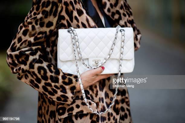 Gitta Banko wearing a velvet blazer with leopard print by Jadicted, beige silk dress by Anine Bing, light-grey Jeans by True Religion, white Chanel...