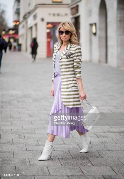 Gitta Banko wearing a white and khaki striped blazer by AirField lavendercolored tshirt by Juvia lavendercolored pleated skirt by Front Row white...