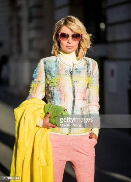 Gitta Banko wearing a yellow turtleneck sweater from Zara a short tweed jacket by Air Field pinkcolored cotton trousers by Humanoid a long yellow...