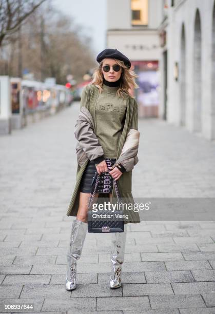 Gitta Banko wearing an olivegreen shirt and cardigan with golden stripes by AirField khaki colored bomber jacket from Zara black leather skirt with...