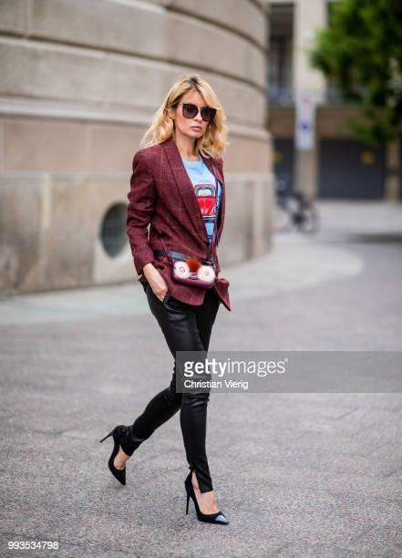 Gitta Banko wearing burgundy checked tweed blazer by Hironai Paris blue hand painted Tshirt with motive by Wodka Ogurez black leather pants with...