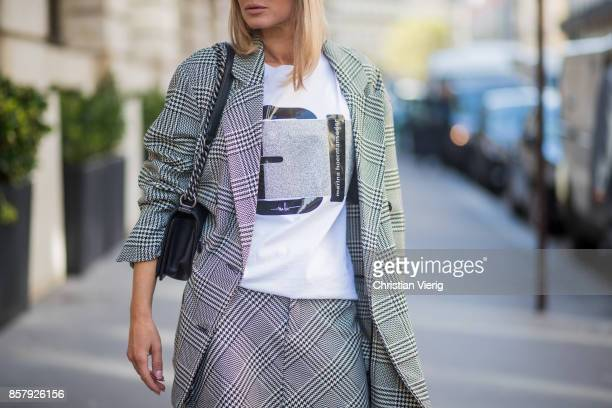 Gitta Banko wearing checked blazer and skirt from Zara tshirt by Marina Hoermanseder white bowembellished lace leather sandals by Stella Luna black...