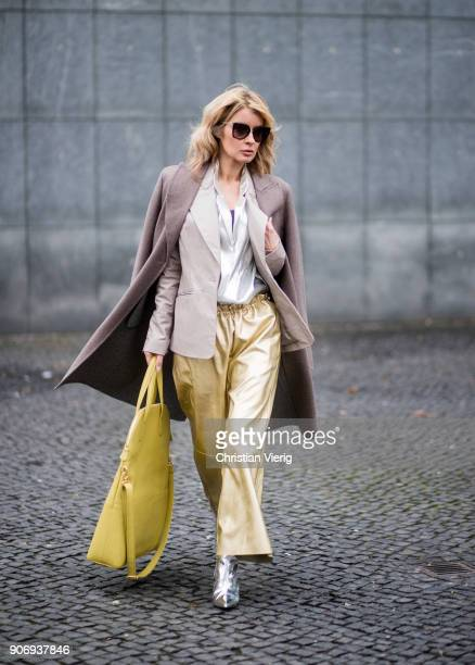 Gitta Banko wearing golden paper trousers by MM6 Martin Margiela silver blouse from HM shiny beige leather blazer by Dawid Tomaszewski taupe colored...