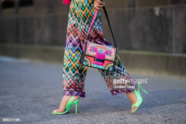 Gitta Banko wearing multicolored trousers by Missoni ultra violet offshoulder cashmere sweater and pink cashmere scarf by Lamaii Cashmere lime green...