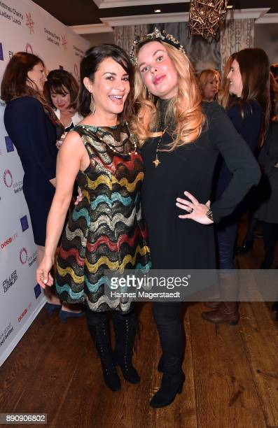 Gitta Saxx and Julia K attend the DKMS LIFECharity Ladies Christmas Lunch at Kaefer Schaenke on December 12 2017 in Munich Germany