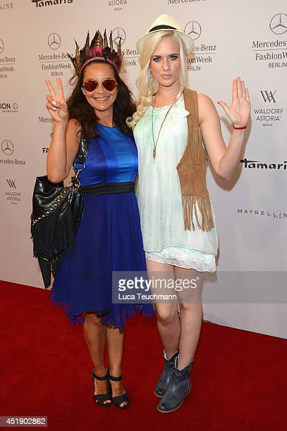 Gitta Saxx and Sarah Knappik attend the Marcel Ostertag show during the MercedesBenz Fashion Week Spring/Summer 2015 at Erika Hess Eisstadion on July...