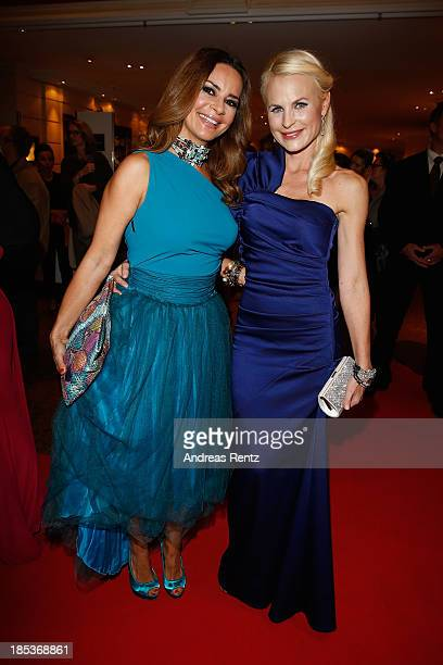 Gitta Saxx and Sonja Kiefer arrive for the 7th Audi Generation Award 2013 at Hotel Bayerischer Hof on October 19, 2013 in Munich, Germany.