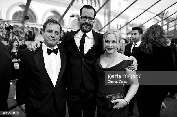 Giuest artist Eric White and actress Patricia Arquette attend TNT's 21st Annual Screen Actors Guild Awards at The Shrine Auditorium on January 25...