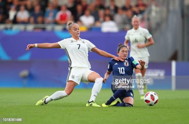 Giula Gwinn of Germany tackles Fuka Nagano of Japan during the FIFA U20 Women's World Cup France 2018 Quarter Final quarter final match between...