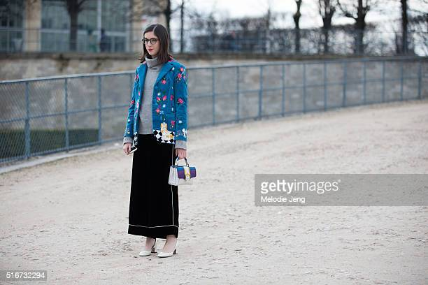 Giulia Baggini wears a blue floral Vivetta jacket with a dog print loose Jucca cropped trousers a white purple and blue Paula Cademartori purse and...