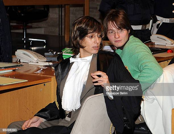 Giulia Bongiorno, the lead lawyer in Raffaele Sollecito's defence team speaks to Raffaele Sollecito during the Meredith Kercher Trial for the closing...