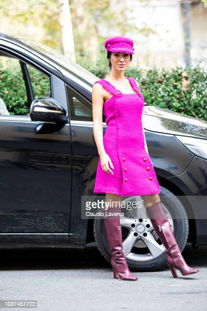 Giulia De Lellis wearing fuchsia dress and hat and bordeaux heeled boots is seen after the Blumarine show during Milan Fashion Week Spring/Summer...