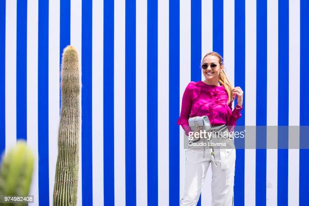 Giulia Gaudino wearing purple shirt and black and white pants is seen during the 94th Pitti Immagine Uomo at Fortezza Da Basso on June 14 2018 in...