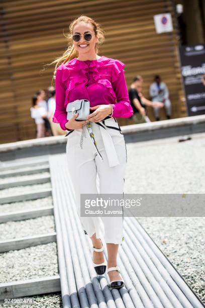 Giulia Gaudino wearing purple shirt black and white pants and Preventi by Giulia Gaudino shoes is seen during the 94th Pitti Immagine Uomo at...