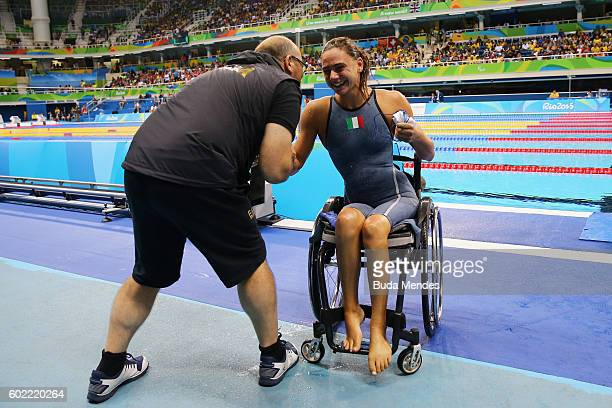 Giulia Ghiretti of Italy celebrates winning the bronze medal after competing in the Women's 50m Butterfly S5 Final on day 3 of the Rio 2016...