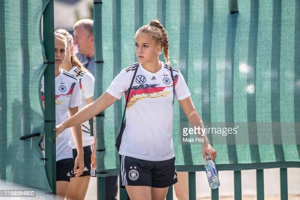 Giulia Gwinn and Klara Buehl of Germany arrive to a training session on June 27, 2019 in Pont-Pean near Rennes, France.