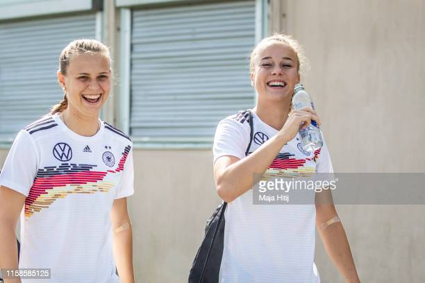Giulia Gwinn and Klara Buehl of Germany smile prior to a training session on June 27 2019 in PontPean near Rennes France