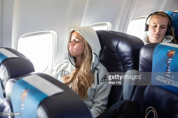 Giulia Gwinn and Merle Frohms of Germany rest during a flight from Lille to Montepellier on June 13, 2019 in Montpellier, France.