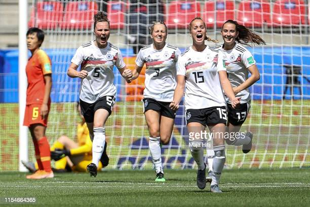 Giulia Gwinn celebrates with teammates after scoring her team's first goal during the 2019 FIFA Women's World Cup France group B match between...