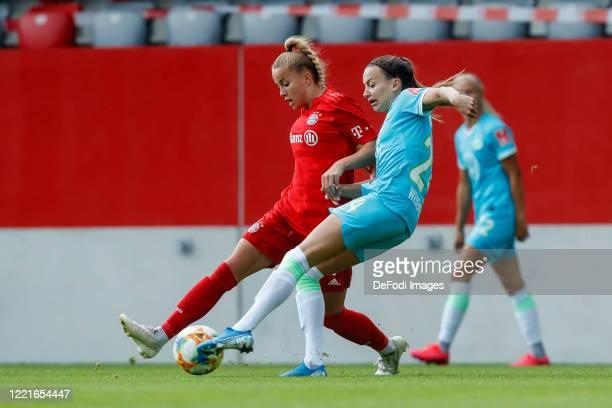 Giulia Gwinn of Bayern Muenchen and Joelle Wedemeyer of VfL Wolfsburg battle for the ball during the Flyeralarm Frauen Bundesliga match between FC...