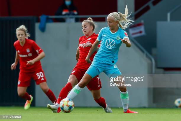 Giulia Gwinn of Bayern Muenchen and Pernille Harder of VfL Wolfsburg battle for the ball during the Flyeralarm Frauen Bundesliga match between FC...