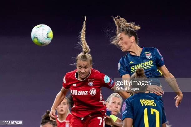 Giulia Gwinn of Bayern Muenchen and Sara Bjork Gunnarsdottir of Olympique Lyon battle for the ball during the UEFA Women's Champions League Quarter...