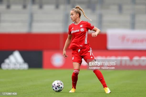 Giulia Gwinn of FC Bayern Muenchen runs with the ball during the Flyeralarm Frauen Bundesliga match between FC Bayern Muenchen Women and SC Sand...