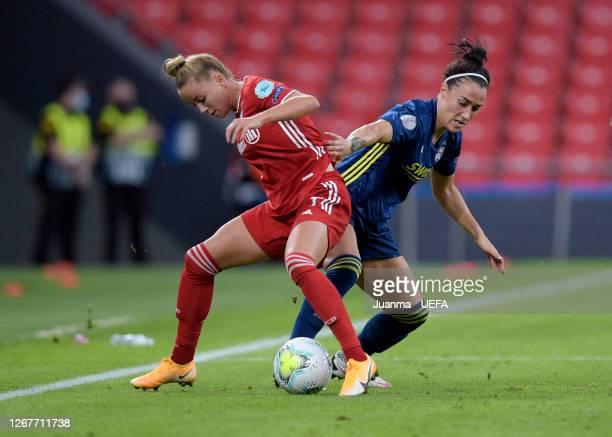 Giulia Gwinn of FC Bayern Munich holds off Lucy Bronze of Olympique Lyon during the UEFA Women's Champions League Quarter Final match between...