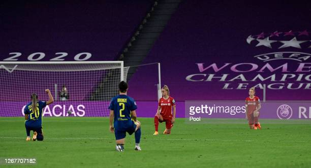 Giulia Gwinn of FC Bayern Munich takes the knee along with her teammates in support of the Black Lives Matter Movement prior to the UEFA Women's...
