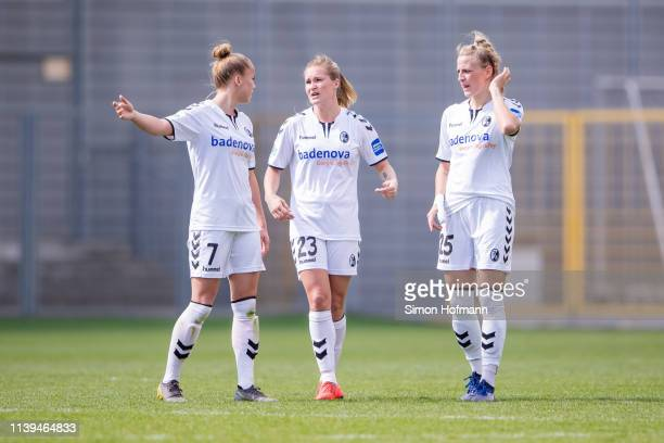 Giulia Gwinn of Freiburg gives directions to Desiree van Lunteren and Virginia Kirchberger of Freiburg during the Women's DFB Cup Semi Final between...