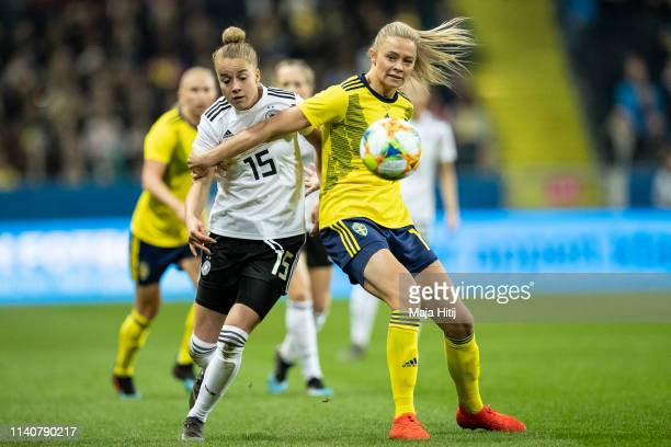 Giulia Gwinn of Germany and Fridolina Rolfoe of Sweden battle for possession during the Sweden v Germany Women's International Friendly match at...